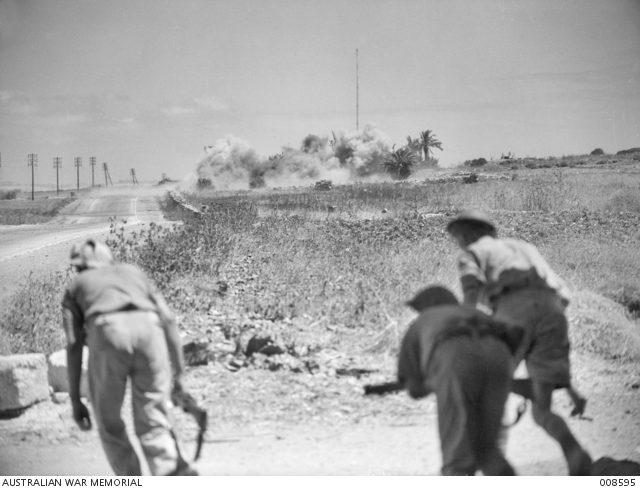 AUSTRALIAN TROOPS WITH COVERING ARTILLERY FIRE KHALDE